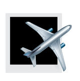 Airplane and picture isolated on white Stock Photography
