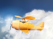 Airplane and pilot in the clouds Royalty Free Stock Image