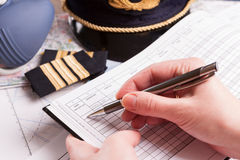 Airplane pilot filling in flight plan Stock Images