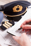 Airplane pilot filling in flight plan Royalty Free Stock Photo