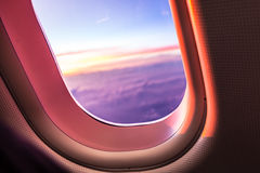 Airplane porthole at sunrise Royalty Free Stock Image