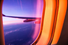 Airplane porthole at sunrise Royalty Free Stock Photography