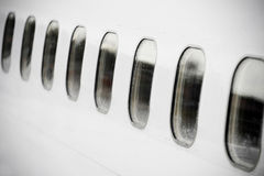 Airplane portholes Royalty Free Stock Photo