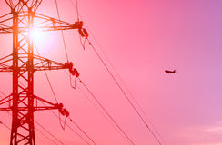 Airplane and power line Royalty Free Stock Photos