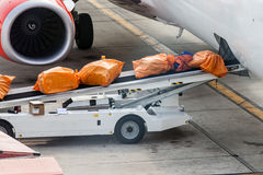 Airplane prepare for fight and loading the bags Royalty Free Stock Photos