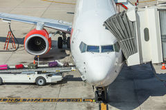 Airplane prepare for fight and loading the bags Royalty Free Stock Image