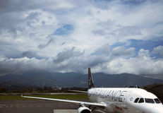 Airplane prepares to flight in airport Costa Rica Royalty Free Stock Image