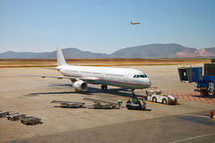 Airplane preparing to the flight. At airport Royalty Free Stock Photos