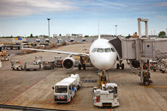 Airplane preparing to the flight. At airport Royalty Free Stock Photography