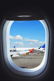 Airplane preparing to flight, view from aircraft window. On the ground Royalty Free Stock Photo