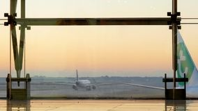 Airplane preparing to take off in the International airport of Barcelona stock video footage
