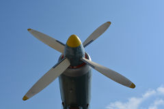 Airplane propeller engine against blue sky closeup royalty free stock photo