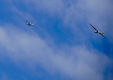 Airplane pulling glider Stock Photography