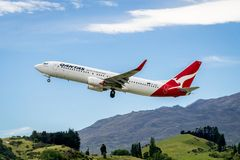 Airplane of Qantas Airways takes off from airport. Queenstown, NEW ZEALAND - DEC 9, 2016: Airplane of Qantas Airways takes off from runway in Queenstown airport Stock Images