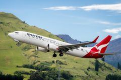 Airplane of Qantas Airways takes off from airport. Queenstown, NEW ZEALAND - DEC 9, 2016: Airplane of Qantas Airways takes off from runway in Queenstown airport Royalty Free Stock Image