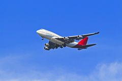 Airplane QFB747 MidAir Stock Photography