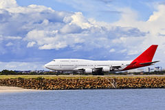 Airplane QFB747 Side Beach Stock Photos