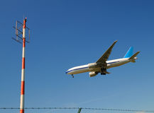 Airplane and radio mast Royalty Free Stock Photo