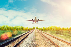 Airplane and railway at sunset. Travel or Transporttation backgr Royalty Free Stock Image