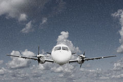 Airplane in the rain Stock Photography