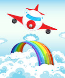 Airplane and rainbow Stock Photos