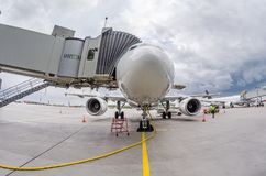 Airplane at the ramp airport terminal, wide viewing angle stock image