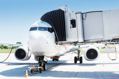 Airplane ready for boarding in airport hub. Stock Image