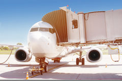 Airplane ready for boarding in airport hub. Royalty Free Stock Photography