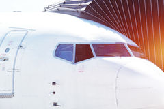 Airplane ready for boarding in airport hub. Royalty Free Stock Photos