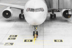 Airplane ready for boarding in a airport hub Stock Photo