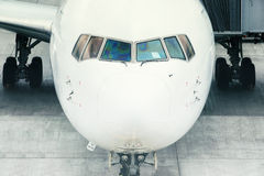 Airplane ready for boarding in a airport hub Stock Images