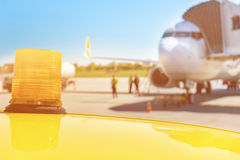 Airplane ready for boarding in airport hub, follow me car Royalty Free Stock Photo