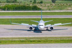 Airplane ready to take off from runway. A big Royalty Free Stock Images