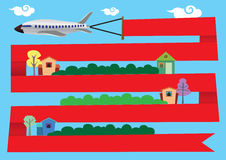 Airplane with Red Banner around Residential Area Royalty Free Stock Photos