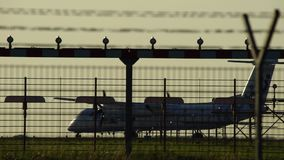 Airplane redy to take off in silhouette against an orange sunset sky. Airport Hannover. Germany stock video