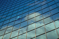 Airplane reflect on building glass Royalty Free Stock Images