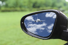 Airplane reflected in rear mirror Royalty Free Stock Images