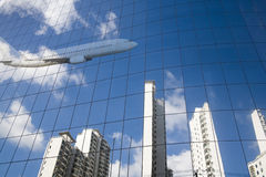 Airplane reflection Stock Photography