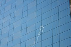 Airplane reflexion on a modern building Stock Photos