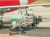 Airplane Refueling After Landing at the Airport. Refueling by Airline Ground Crew royalty free stock photo