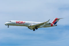 Airplane Regional Airlines F-GRGD Embraer ERJ-145 is flying to the runway. Stock Photography