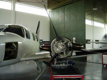 Airplane repair. Cessna jet on repair in a hangar stock photo