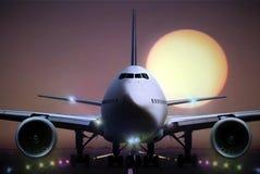 Airplane on runaway during sunset Royalty Free Stock Photos