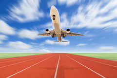 Airplane and Running track with green grass and blue sky white c Stock Image