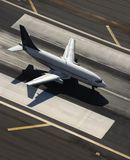 Airplane on runway. royalty free stock image