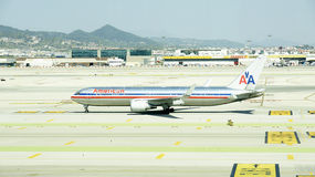 Airplane on the runway of Barcelona Stock Images