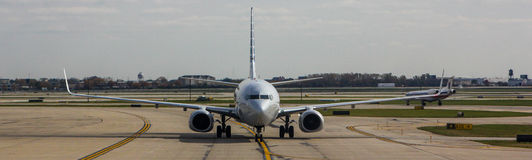 Airplane on runway Stock Photography