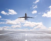 Airplane on runway. And looking at airplane in blue sky Royalty Free Stock Photos