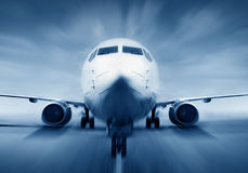 Airplane in the runway Stock Photography
