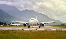 Airplane in the runway ready to take off Royalty Free Stock Images